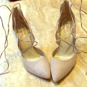 Nude pointy toed heels